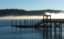 Morning fog over Hood Canal, from the Port of Hoodsport's public dock.