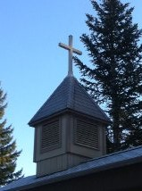 St. Germain's church steeple; the bell rings each Sunday at 10am.